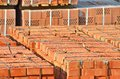 Stack of brick orange clay silicate on construction site Royalty Free Stock Photo