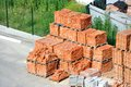 Stack of brick red clay on construction site Royalty Free Stock Photos