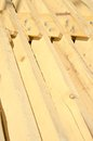 Stack of building lumber at construction site ready for montage Stock Photos