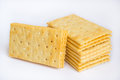 Stack of butter crackers on white background Royalty Free Stock Photo