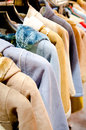 Stack of casual coat on hangers female clothes hanging clothes rack Stock Image