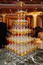 Stack of champagne glasses on table in wedding party Royalty Free Stock Images