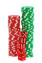 Stack of chips and dice isolated Royalty Free Stock Photos