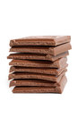 Stack of chocolate pieces on a white background Stock Images