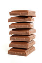 Stack of chocolate pieces on a white background Royalty Free Stock Image