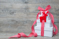 Stack of christmas gifts with ribbon and bow on old wooden background Royalty Free Stock Image