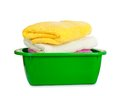 Stack of clean fresh towels in the green basin Stock Images