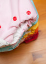 Stack of cloth diapers on a wooden table Royalty Free Stock Photo