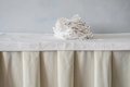 Stack of cloth towels on white table in the restaurant Royalty Free Stock Photo