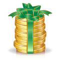 Stack of coins with green bow Royalty Free Stock Photo