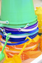 Stack of colored beach pails a the colors are turquoise purple blue yellow and orange Stock Image