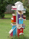 Stack of colorful birdhouses mailbox with Stock Photography