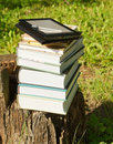 Stack of colorful books and electronic book reader Royalty Free Stock Photos
