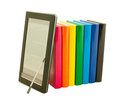 Stack of colorful books and electronic book reader Stock Photography