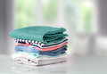 Stack colorful cotton clothes on table empty space background. Royalty Free Stock Photo