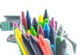 A stack of colorful crayons on an isolated white background Royalty Free Stock Photo
