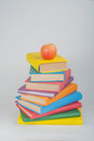 Stack of colorful real books, apple on white background, partial view. Back to school, Copy Space. Education .