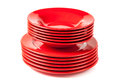 Stack of colorful red ceramics plates Royalty Free Stock Photo