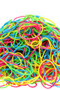 Stack of colorful rubber bands isolated on white background Royalty Free Stock Photos