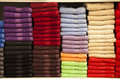 Stack of colorful terry towels folded. Shop Home Royalty Free Stock Photo