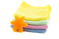 A stack of colorful towels and soap in the shape Royalty Free Stock Photo