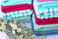 Stack of colorful towelsand flowers closeup picture Royalty Free Stock Photos