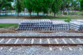 Stack of concrete railway sleepers near railroad Royalty Free Stock Photos