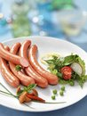 Stack of cooked sausages hq studio shot meat products on white plate Royalty Free Stock Image