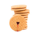 Stack of cookie biscuits with filling on a white background Stock Image