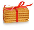 Stack of cookies tied with red ribbon isolated on white background Stock Image