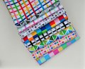 Stack of cotton quilting fabric anne kelle rainbow remix designer for robert kaufman Stock Image
