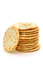 Stack of crackers on white background in vertical format Royalty Free Stock Image