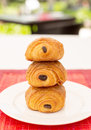 Stack of danish pastry with chocolate on white plate Royalty Free Stock Image