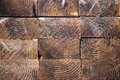 Stack of dark wood planks textures in lumber yard Stock Images
