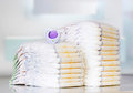 Stack of diapers on table indoors. Royalty Free Stock Photo
