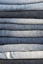 Stack of different old worn blue jeans Stock Photo