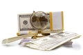 The stack of dollars with crystal globe on a white background Stock Photo