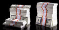 Stack of dollars isolated on black background Stock Images