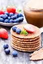 Stack of Dutch caramel waffles with blueberry and strawberry wi Royalty Free Stock Photo
