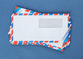 A stack of envelopes on a blue Royalty Free Stock Photo