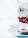 Stack of fine porcelain tea cups and saucers Royalty Free Stock Photo