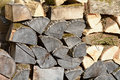 Stack of firewood piled high for winter in garden home Stock Images