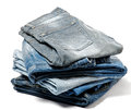 Stack of Folded Old Jeans Stock Images