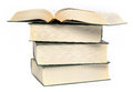 A stack of four books Royalty Free Stock Photo