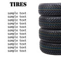 Stack of four wheel new black tyres for winter car driving isola Royalty Free Stock Photo
