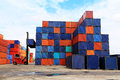 Stack of freight containers at the docks with truck Royalty Free Stock Photo