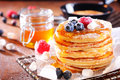 Stack of fresh golden pancakes or flapjacks Royalty Free Stock Photo