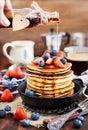 Stack of freshly prepared banana  pancakes with fresh berries Royalty Free Stock Photo
