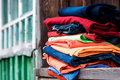 Stack of garment colourful on the wooden parapet Royalty Free Stock Images