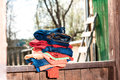Stack of garment colourful on the wooden parapet Royalty Free Stock Photography